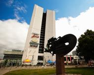Asisbiz Walking down Viru valjak Amarillo Conference Center and park statue Tallinn Harju Estonia 01