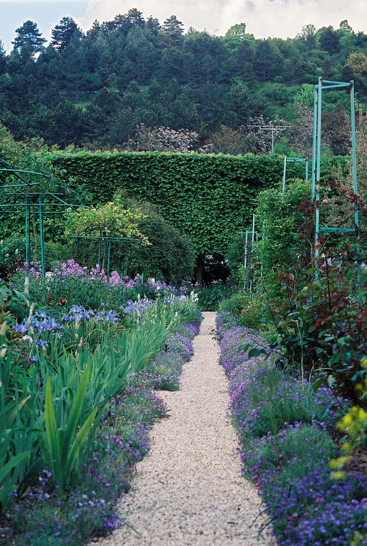 Travel to Claude Monet home or Chateau garden pathways in Giverny France 01