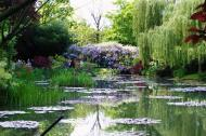 Asisbiz Travel to Claude Monet Water Lily Pond in Giverny France Japanese bridge 02