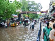 Asisbiz Madurai Sri Meenakshi Temple main road flooding India May 2005 05