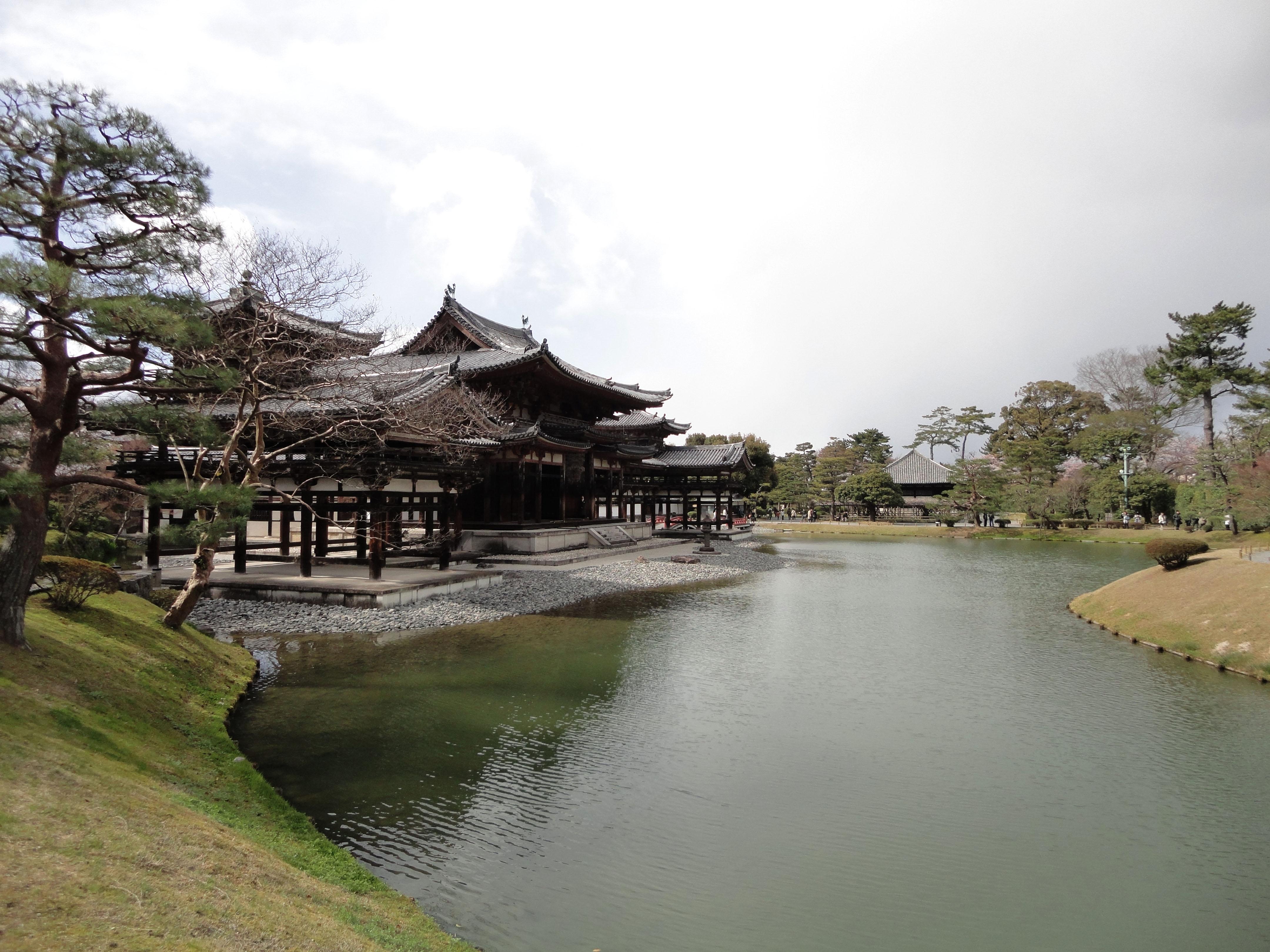 Byodo in temple Phoenix Hall Jodo shiki garden pond side view Japan 01