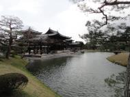 Asisbiz Byodo in temple Phoenix Hall Jodo shiki garden pond side view Japan 02