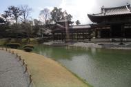 Asisbiz Byodo in temple outer path Phoenix Hall Jodo shiki garden pond Kyoto Japan 01