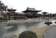 Asisbiz Byodo in temple outer path Phoenix Hall Jodo shiki garden pond Kyoto Japan 05