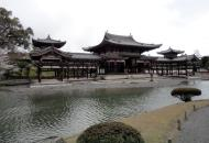 Asisbiz Byodo in temple outer path Phoenix Hall Jodo shiki garden pond Kyoto Japan 06