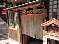 Asisbiz Kofuku ji Temple area interesting rope design shop entrance 01