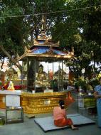 Asisbiz Yangon A Thi Tha Di Bronze Statue of Buddha garden area Dec 2009 02