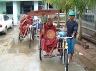 Asisbiz Hmawbi Monastery Sayadow performing his monks duty Dec 2000 03