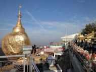 Asisbiz Kyaiktiyo Pagoda paying homage to the Buddha with flower offerings 01