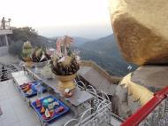 Asisbiz Kyaiktiyo Pagoda paying homage to the Buddha with food offering 01