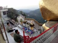 Asisbiz Kyaiktiyo Pagoda paying homage to the Buddha with food offering 03
