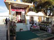 Asisbiz Kyaiktiyo Pagoda paying homage to the Buddha with food offering 04