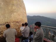 Asisbiz Kyaiktiyo Pagoda paying homage to the Buddha with gold leaf 2009 03