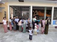 Asisbiz Meilamu Pagoda donating gold leaf Yangon Myanmar 02