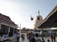 Asisbiz Meilamu Pagoda donating gold leaf Yangon Myanmar 03