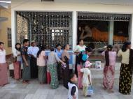 Asisbiz Meilamu Pagoda donating gold leaf Yangon Myanmar 04