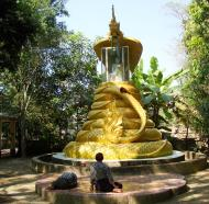 Asisbiz U To near Hle Guu dragon protecting the Buddha statue 2010 01