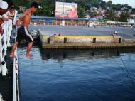 Asisbiz Youngster jumping off the Batangas ferry for coins Calapan Port Oriental Mindoro Philippines 2009 01