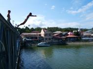 Asisbiz Kids diving of Naujan Estrella bridge Oriental Mindoro Philippines Feb 2006 01
