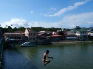 Asisbiz Kids diving of Naujan Estrella bridge Oriental Mindoro Philippines Feb 2006 04