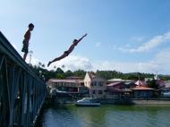 Asisbiz Kids diving of Naujan Estrella bridge Oriental Mindoro Philippines Feb 2006 05