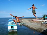 Asisbiz Kids diving of Naujan Estrella bridge Oriental Mindoro Philippines Feb 2006 09