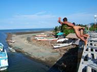 Asisbiz Kids diving of Naujan Estrella bridge Oriental Mindoro Philippines Feb 2006 24