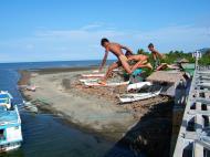 Asisbiz Kids diving of Naujan Estrella bridge Oriental Mindoro Philippines Feb 2006 25