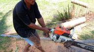 Asisbiz Step by step guide on how to cut straight using chainsaw the grip keeps the balance Philippines 01