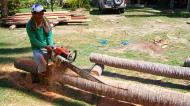 Asisbiz The master shows step by step how to cut straight using chainsaw to produce coco lumber Philippines 02