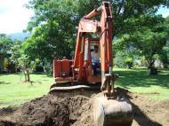 Asisbiz Using a Hitachi Backhoe to remove coco tree stumps Tabinay Philippines 01