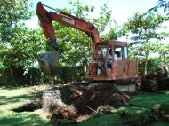 Asisbiz Using a Hitachi Backhoe to remove coco tree stumps Tabinay Philippines 04