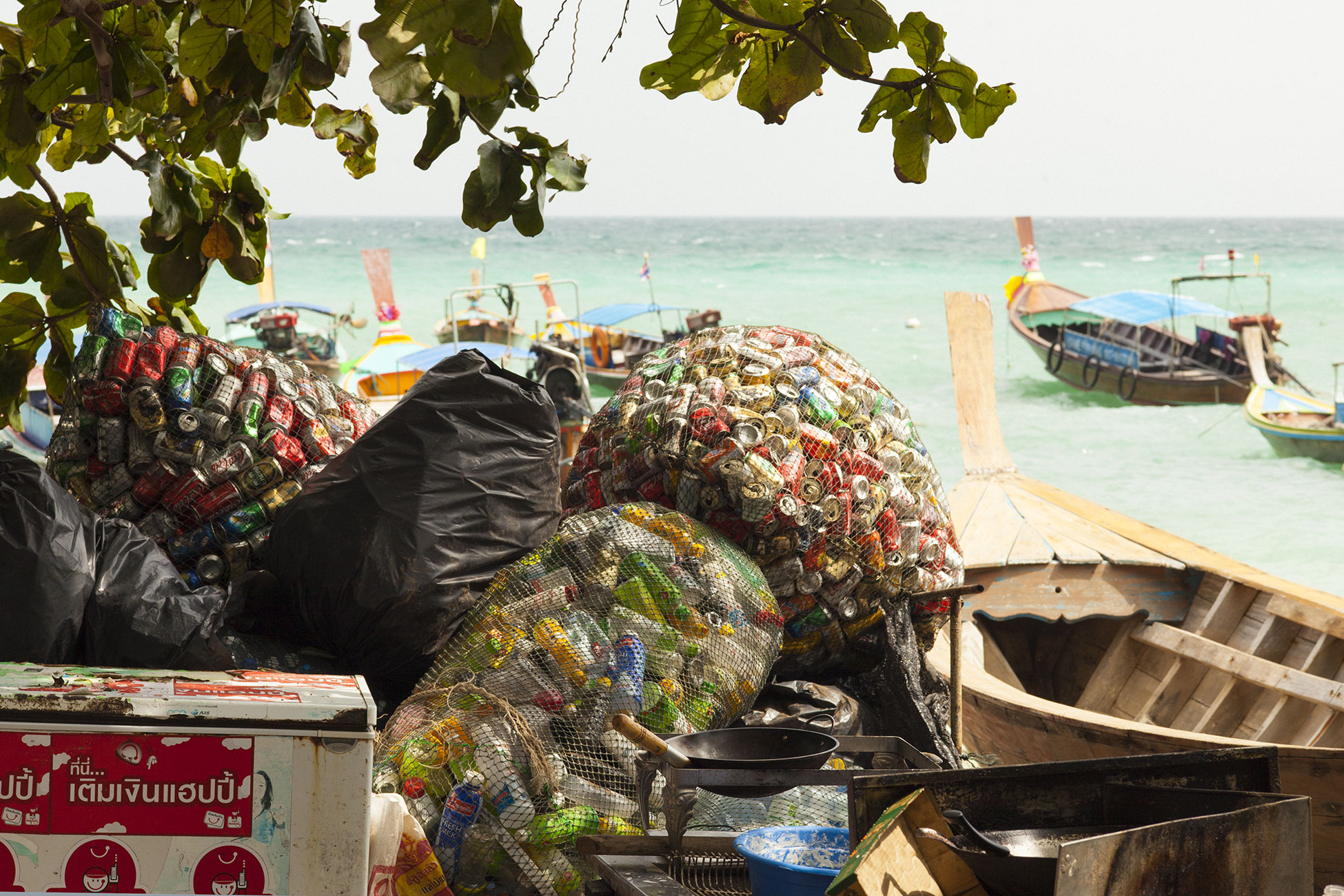 Recycling rubbish the other side to tourism Ko Phi Phi Phuket Province Thailand