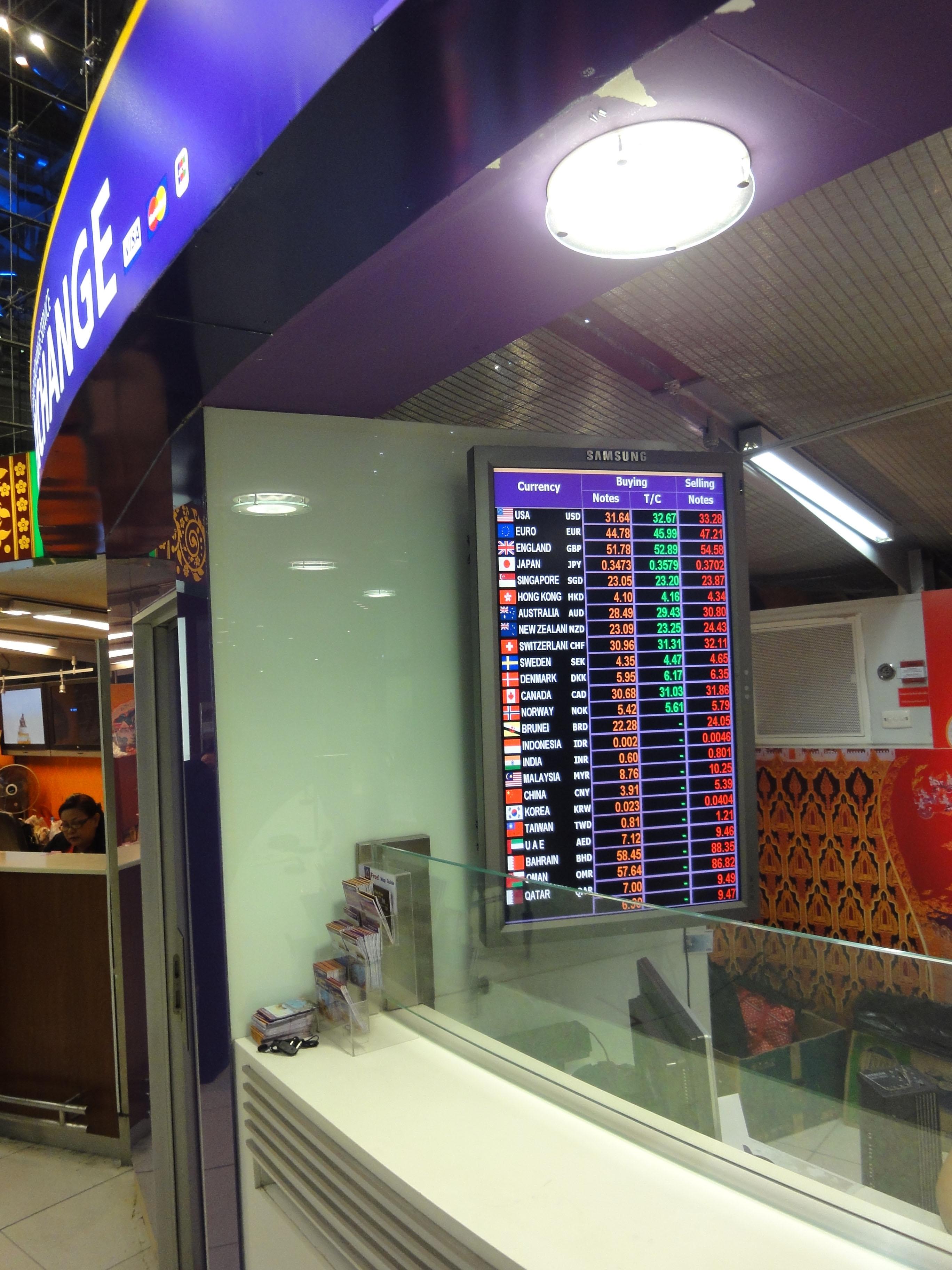 Bank exchange rates sign Suvarnabhumi Airport Thailand 2009 01