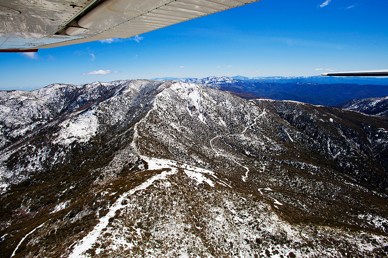 Flying over the snow covered San Rafael Mountain Range 6,820 ft California May 2012 02
