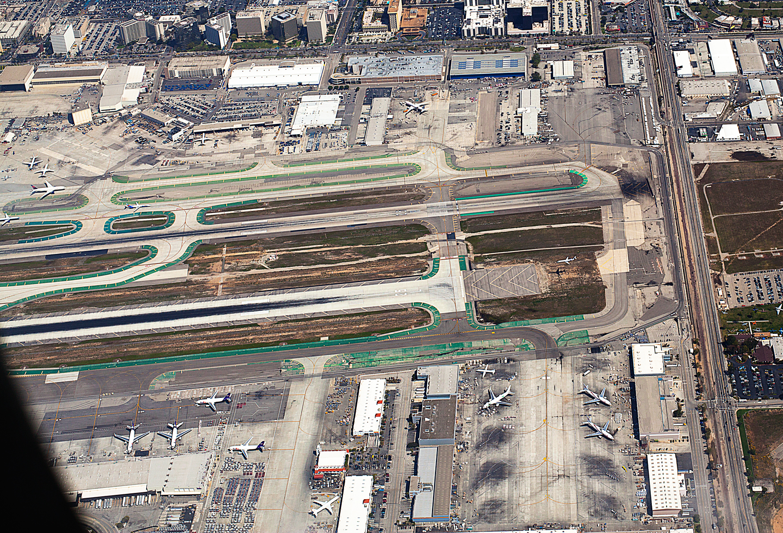 Taken at 3,000 feet over LAX as a McDonnell Douglas MD 90 comes into land RWY 25L 01