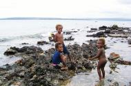 Asisbiz Kids playing on the reef Espiritu Santo Vanuatu 01