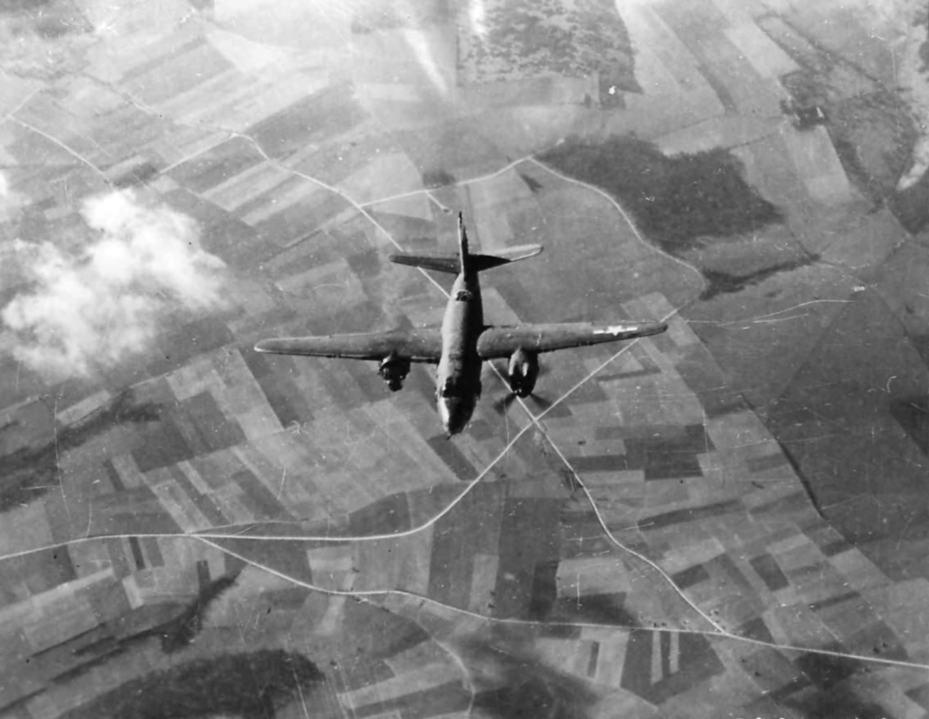 USAAF 41 35000 B 26C Marauder 323BG455BS YUR Swamp Chicken hit by flak over France 55 Feb 1944 MACR 2056 01