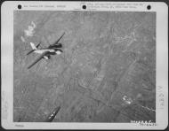 Asisbiz USAAF B 26 Marauder 386BG555BS YAJ leaving the target area 1 Jun 1944 01