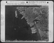 Asisbiz USAAF B 26B Marauder 5AF bombing Barges in Borgen Bay New Britain note shadows of attacking USAAF B 26s above Nov 1943 01