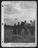 Asisbiz USAAF B 26B Marauder takes off for another mission is watched by English farmers 1943 01