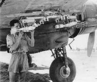 Asisbiz Beaufighter being armed with baby training bombs Tunisia 1943 01