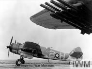 Asisbiz Beaufighter TFX RCAF 404Sqn 2H NE355 fully loaded with rocket projectiles at Davidstow Moor Cornwall IWM MH7465