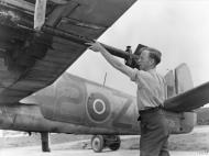 Asisbiz Beaufighter TFX RCAF 404Sqn 2Z LZ295 being fitted with 3 inch 25lb rockets at Davidstow Moore Cornwall IWM MH7466