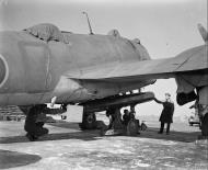 Asisbiz Beaufighter VI RAF 144Sqn being fitted with an 18in Mk XV torpedo IWM CH9769