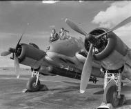 Asisbiz Beaufighter VIC (ITF) RAF 144Sqn crew stand by the cockpit of their aircraft at Tain Ross shire IWM CH9765