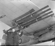 Asisbiz Beaufighter X RCAF 404Sqn 2G being fitted with 3 inch 25lb rockets at Davidstow Moor Cornwall IWM CH13179