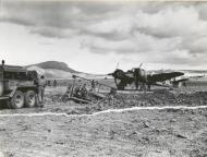Asisbiz A RAF Beaufighter MkVIF Red C sit ideally by as a bulldozer files a bomb crator 01