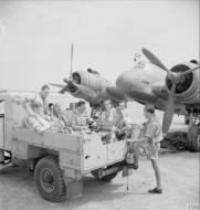 Asisbiz Aircrew RAF 252Sqn climb into the back of a lorry for the drive to their Headquarters at Idku Egypt IWM CM3619