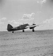 Asisbiz Beaufighter IC RAF 252Sqn F T5137 taking off at El Magrun Libya 1942 IWM CM4422